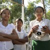 School girls playing soccer in Burma