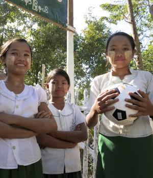 School girls playing soccer in Burma