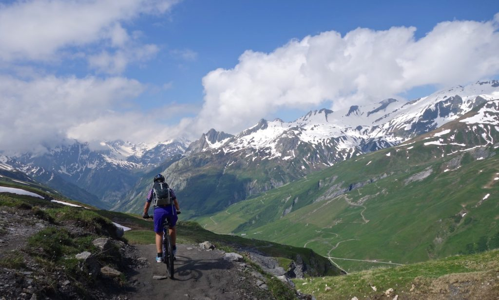 Mountain Biker riding the single trail with views in the Alps