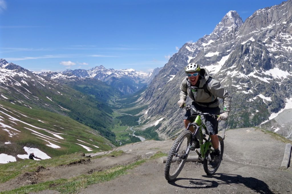Excited mountain biker in the Alps