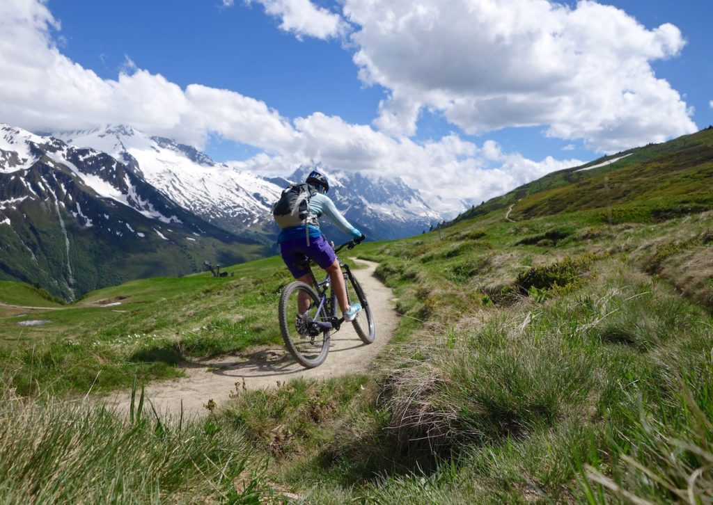Mountain Biker Riding single trails Alps