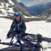 Mountain Biker fallen off in the snow