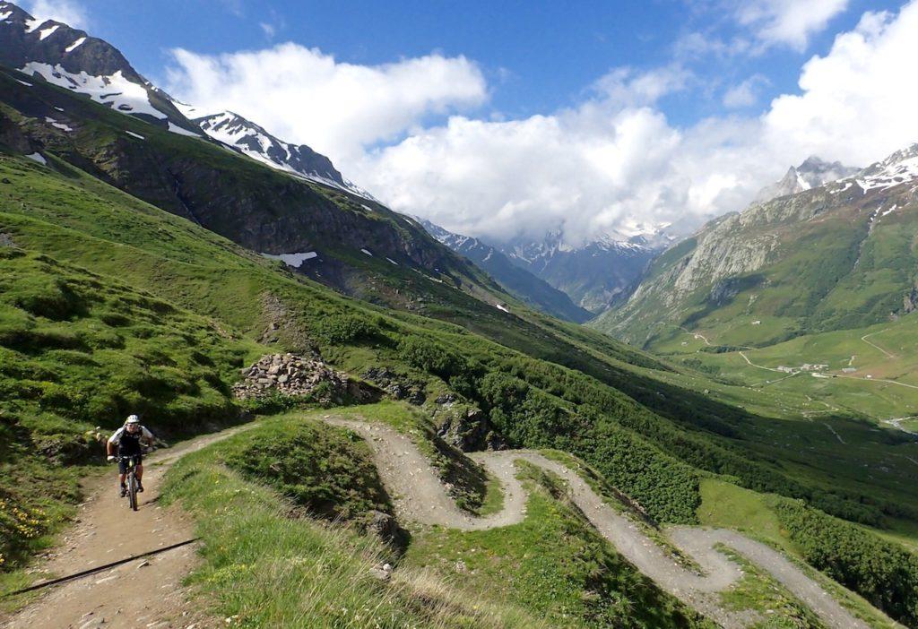 Mountain Biker Climbing the switchbacks on The Tour Du Mont Blanc