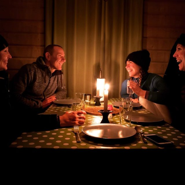 Cosy candlelit cabin dinner for four happy shiny people cabinlifehellip