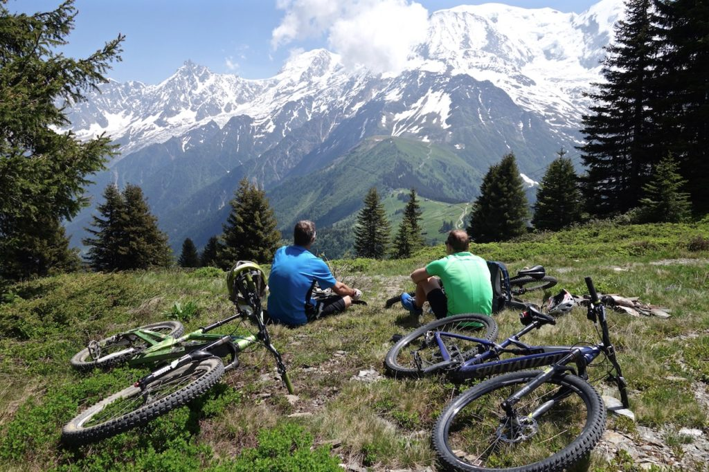 Mountain Bikers Takie in the awe inspiring view of Mont Blanc