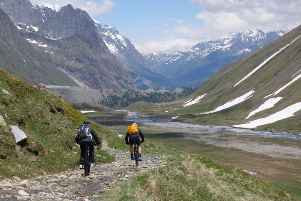 Mountain Biker riding the valley bottom in the Alps