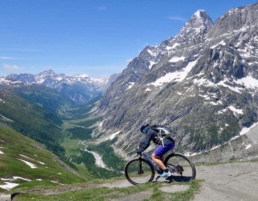 Mountain Biker Riding depending in the Alps