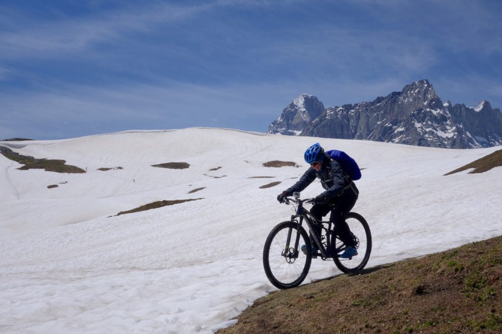 Mountain Biker riding in the snow in the Alps