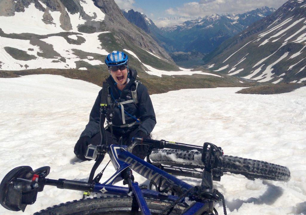 Mountain Biker fallen off in the snow